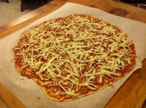 Mix some grated provel into your pizza sauce, enough cheese so that basically you...