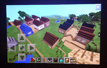 Photo: Q making things in Minecraft