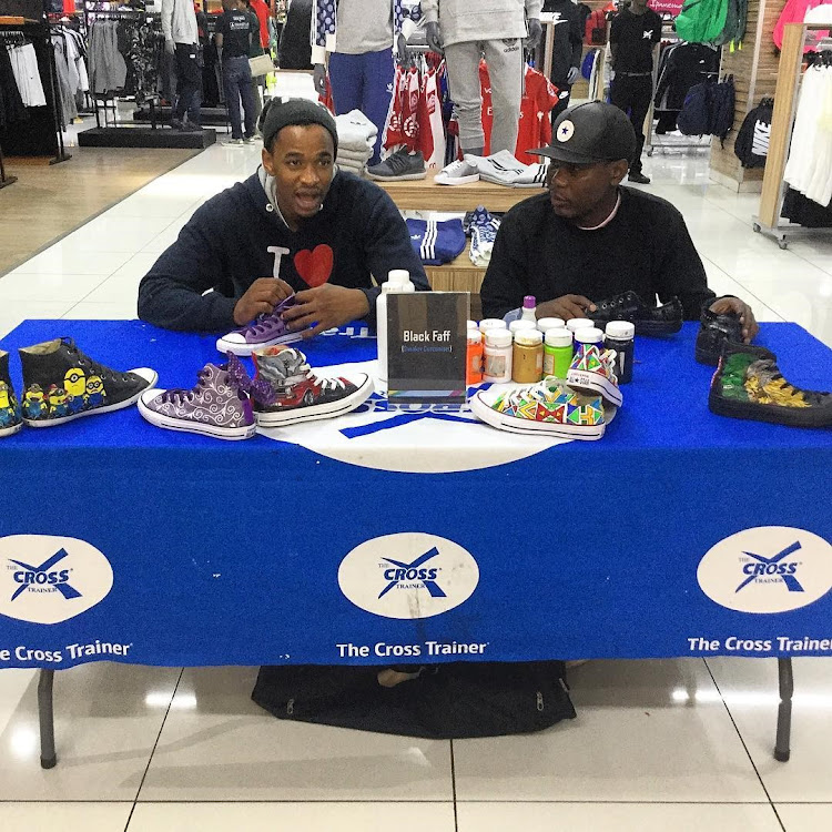 Gent Sibuyi (left) and Thabiso Hadebe (right) at an activation for Black Faff.