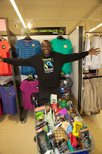 Photo: Massatoma Mounkoro of Mali checks out some Fairtrae products in a Sainsbury's store