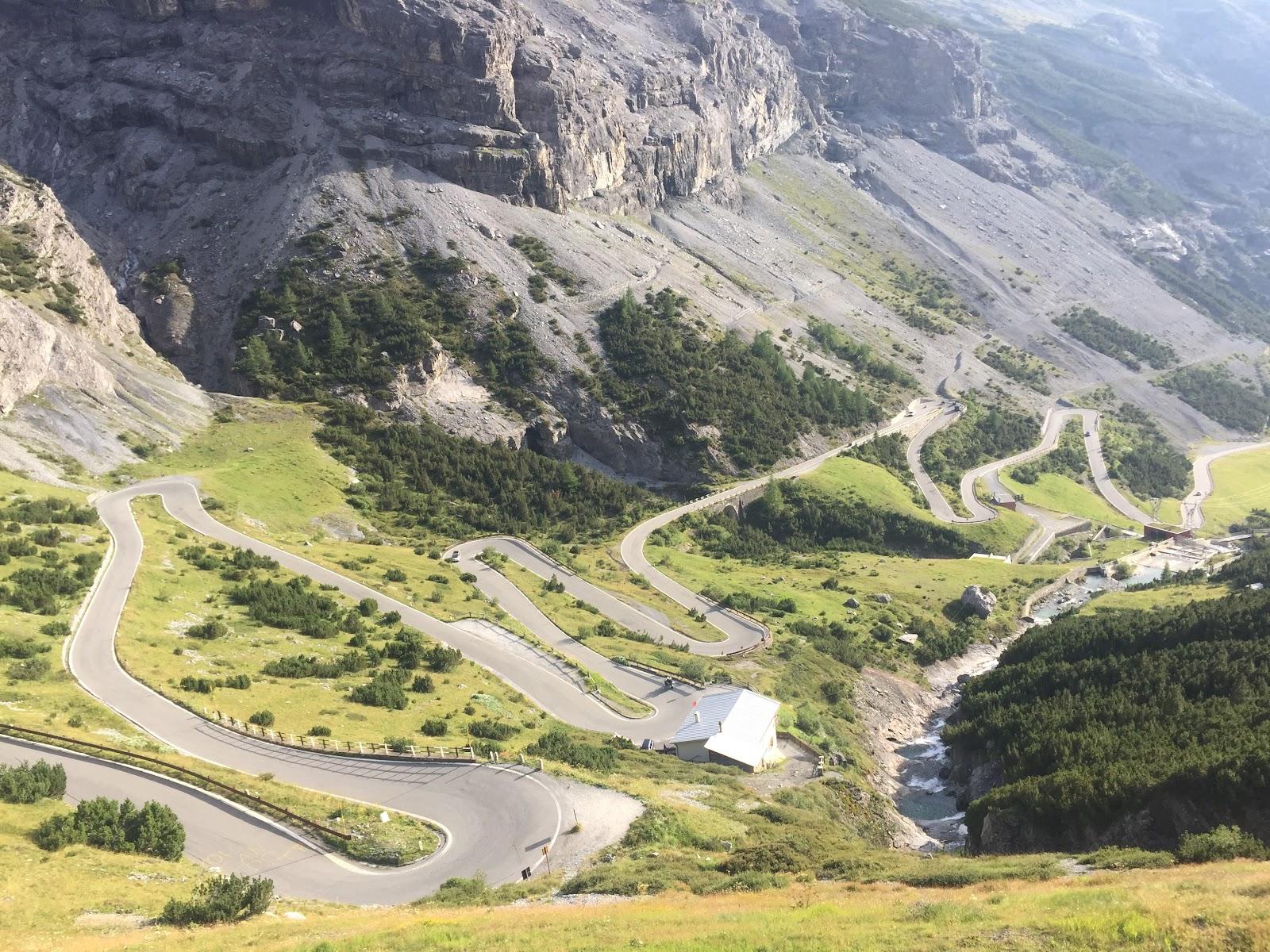 Road bike climb Passo dello Stelvio from Bormio - aerial drone photo of tornanti on stelvio from bormio