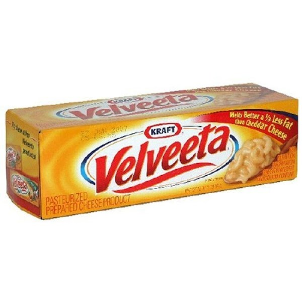 Cube velvetta and cover (until you can't see cheese cubes ) with milk in...