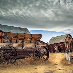 by Becca McKinnon - Buildings & Architecture Decaying & Abandoned ( wagon wheel, wagon, bodie, old barn, old west, well, abandoned )