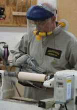 Photo: Jim uses a belt sander at the lathe to make quick work of it -- this is a potential safety hazard -- be very careful if you try this at home.