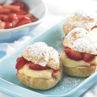 Profiteroles with Vanilla Custard and Strawberries.