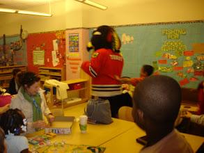 "Photo: ""Tommy Hawk"" , the Blackhawks mascot, visits a 3rd grade classroom."