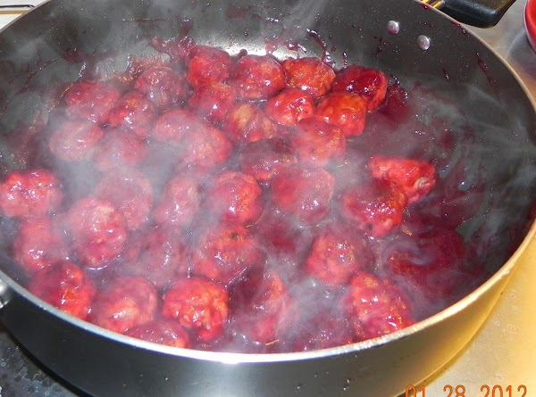 Next, place your cooked meatballs into a pan with your sauce and place on...