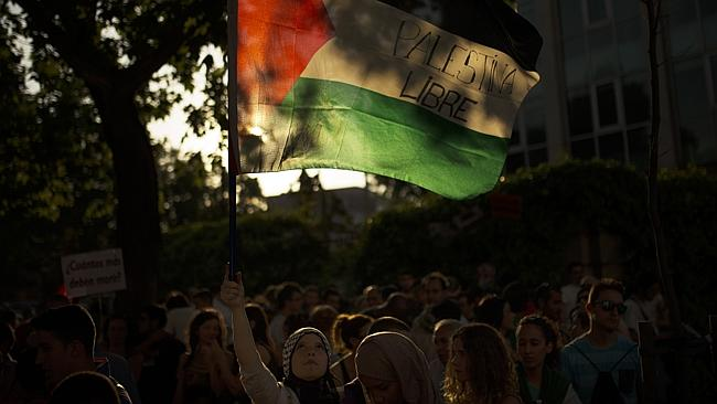"Start of the march ... A protester holds a Palestinian flag that reads: ""Free Palestine"""