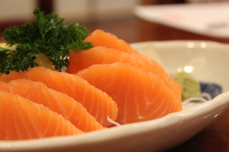 Raw slices of salmon make up sashimi
