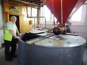 Photo: Elgood's Alan Pateman shows off the old mash tun.