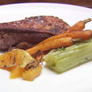 Duck Breast with Braised Celery Heart, Carrots & Orange Sauce.