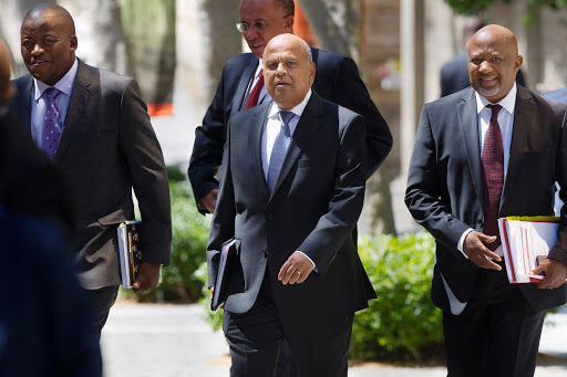 Minister of Finance Pravin Gordhan arrives with members of the Natioanl Treasury Lungisa Fuzile and Mcebisi Jonas to present his 2016 Budget Vote Speech in the National Assembly. Picture Credit: Gallo Images