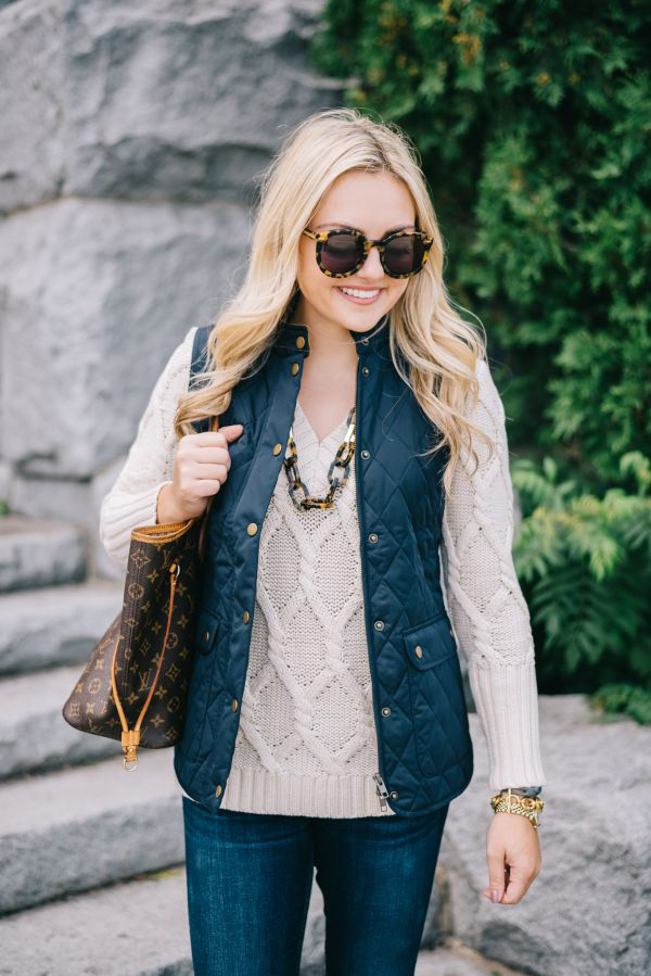 Chic and casual fall outfit with knitted sweater, navy vest and jeans for Clear Spring women