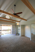Photo: Master Bedroom with vaulted ceiling and exposed beams