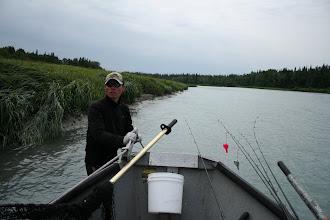 Photo: Nigel Fox of Alaska Drift Away Fishing dragging his boat back up the Kasilof river to run another drift through the hole for king salmon.