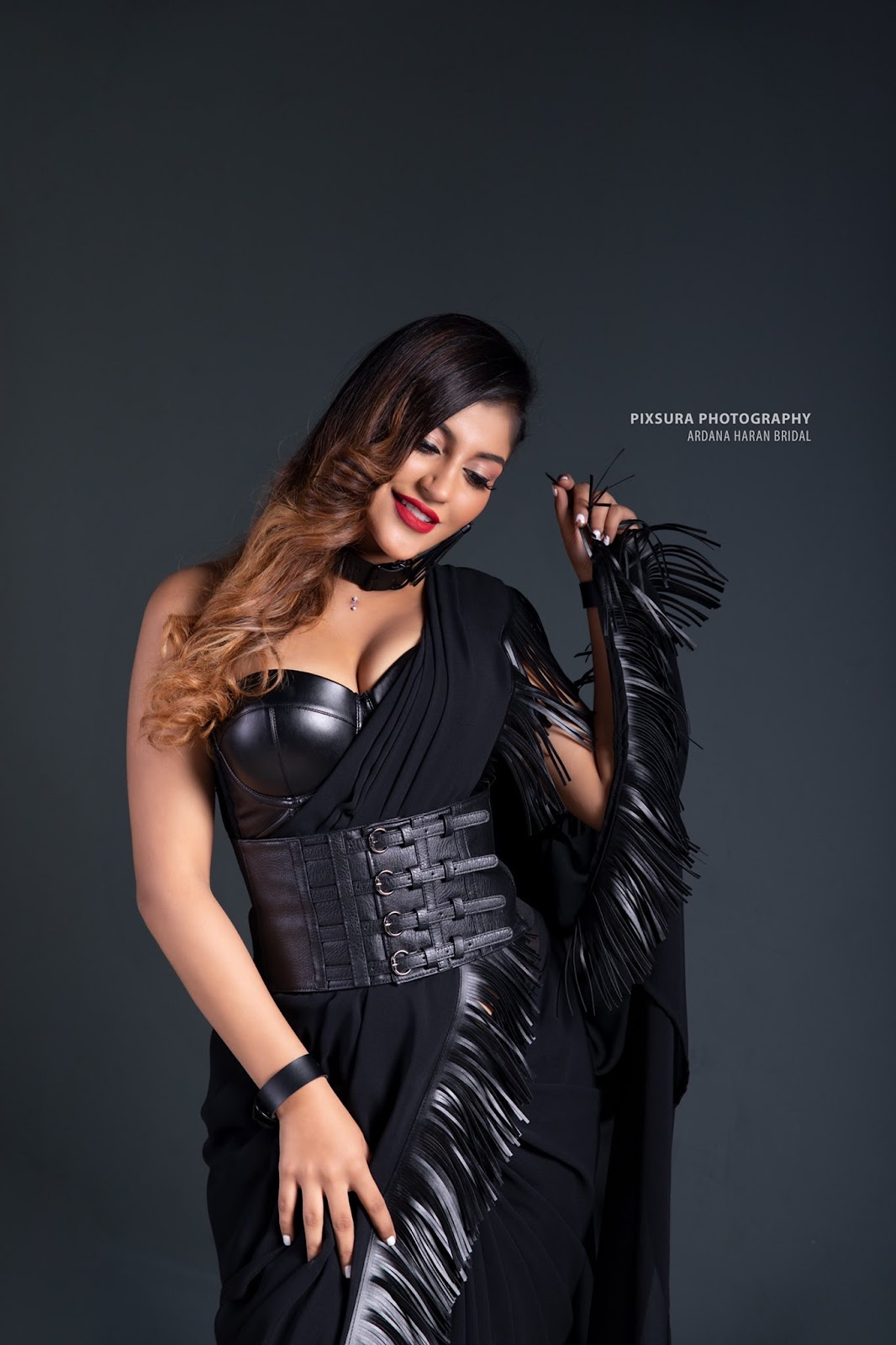 Yashika Aannand in black leather blouse and transparent saree Navel Queens