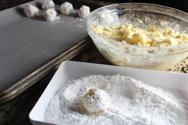 Roll into balls (about walnut size). Roll balls in powdered sugar.