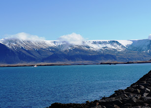 Photo: Looking north across a fjord toward Esja. Esja is not a single mountain, but a volcanic mountain range, made from basalt and tuff-stone.
