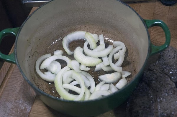 Add the onions to the bottom of the pot.