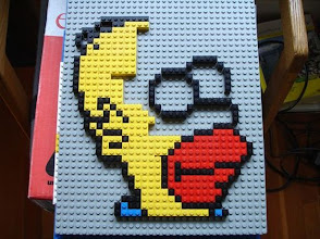 Photo: Image of Homer Simpson, based on a pixelated computer image