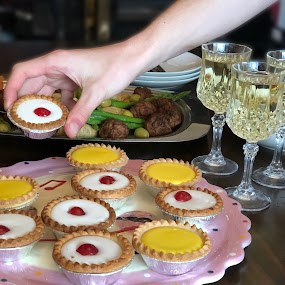 delicious finger food by Annalie Coetzer - Food & Drink Candy & Dessert ( wine, festive, bakewell, tart, joy, plate, together, festivity, hand, cherry, special occasion, sweet, eat, cherries, finger food, lemon )