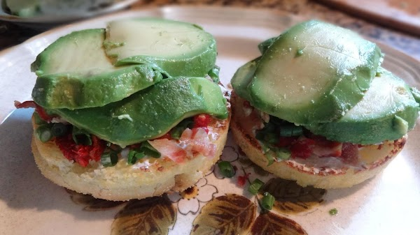 Add 3 thick slices of avocado, and sprinkle with kosher salt and coarse black...