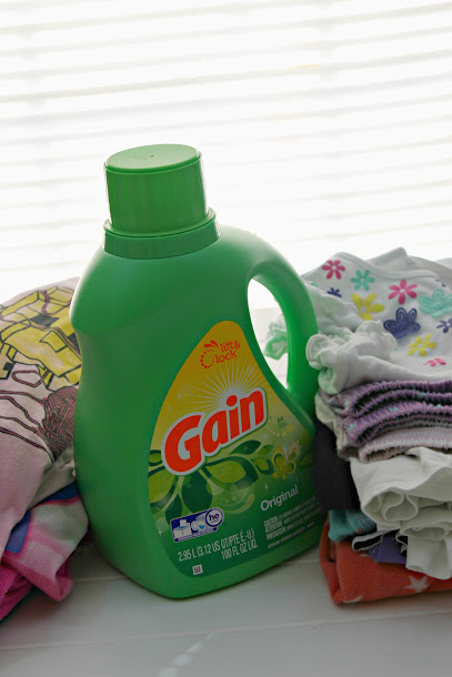 Gardening with kids means getting dirty. Get clothes clean with Gain!