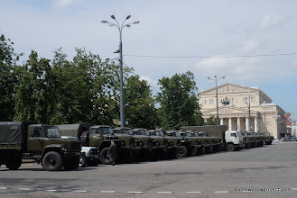 Photo: Outside red square...each truck has a guard standing by, ready to hop in the cab at all times