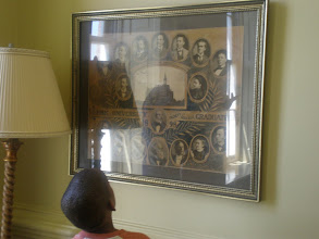 Photo: Jihad looks at one of the class photos.