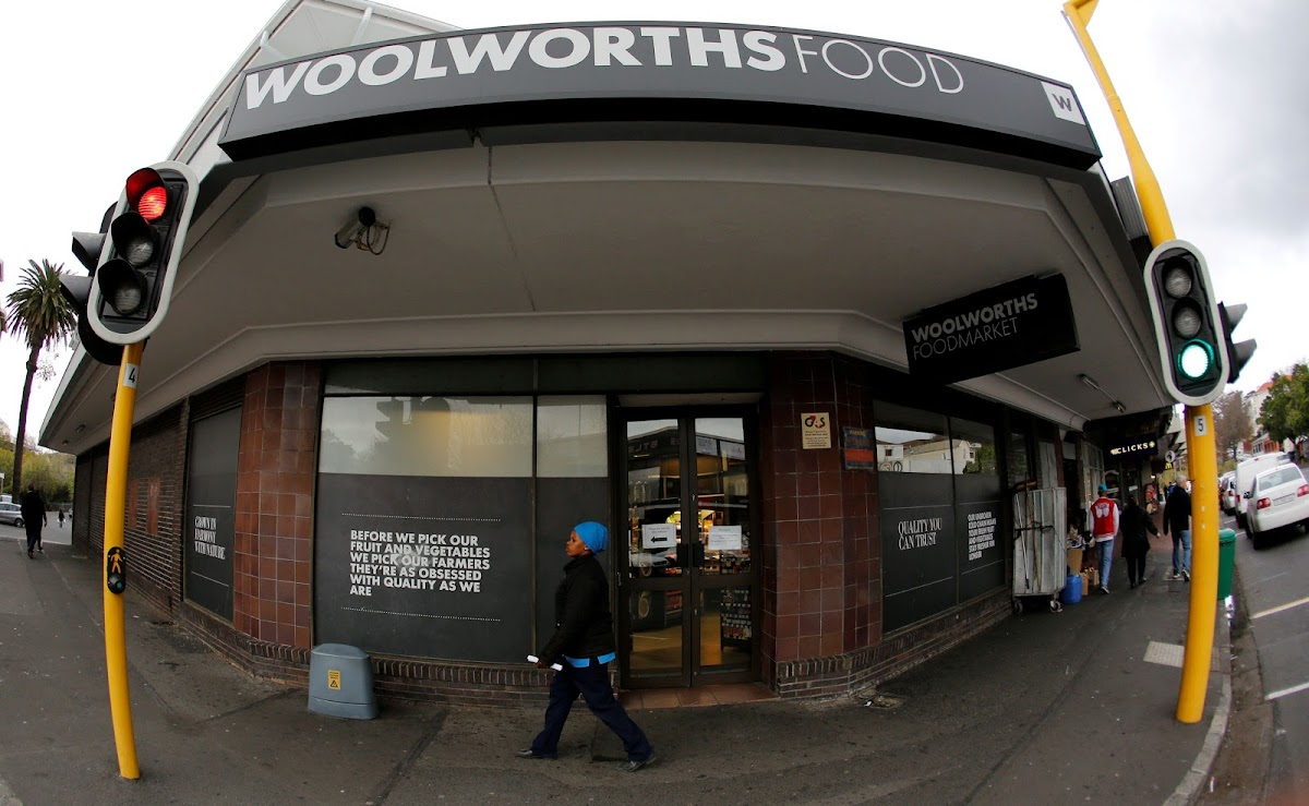 A woman walks past a Woolworths store in Cape Town. Picture  REUTERS MIKE f7303066159c0