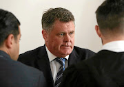 Murder accused property mogul Jason Rohde consults with his  legal team in the Cape Town  High Court. File photo
