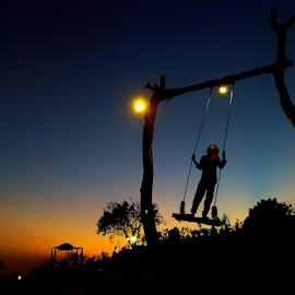 Looking Up by Wahyu Jr. Abadi - Instagram & Mobile Android ( children, street, android, sunset, silhouette, mobile photos, smart, kids )