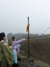 Photo: Wish list being tossed into the crater