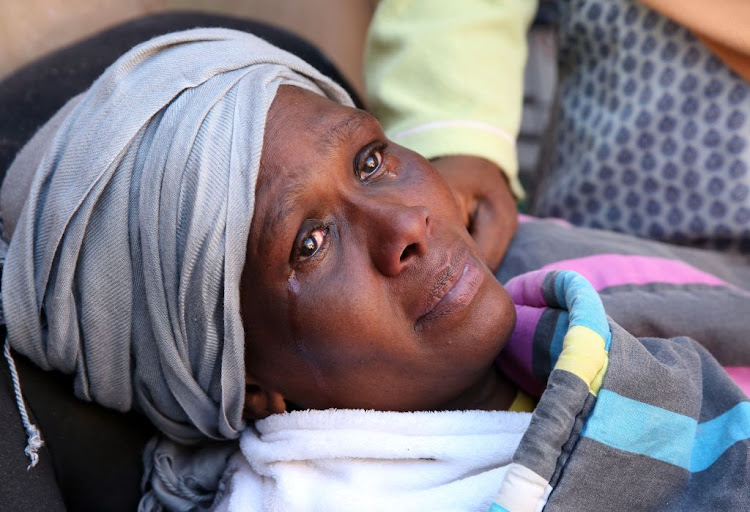 Tears run down Pinky Chili's cheeks after the roof of her home collapsed, killing her daughter Mpume Chili and her granddaughter Sbahle, 2, on June 15, 2018.