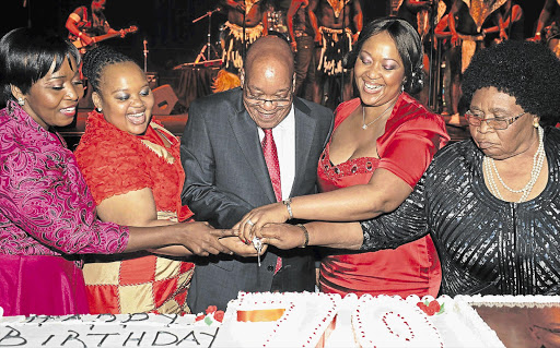 PARTY TIME: President Jacob Zuma cuts his birthday cakes with, from left, bride-to-be Bongi Ngema and wives MaNtuli Zuma, Tobeka Madiba-Zuma and MaKhumalo Zuma at the International Convention Centre in Durban. Picture: GCIS