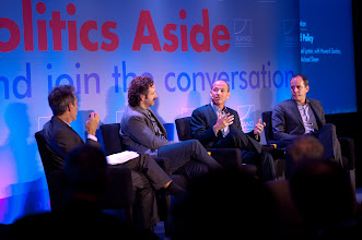 """Photo: Howard Gordon (center) comments during the """"Hollywood and Policy"""" panel discussion Friday, Nov. 16 at the RAND Politics Aside event in Santa Monica as moderator Michael Lynton (far left) and fellow panelists Michael Sheen and David Nevins look on."""