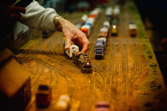 Photo: Enthusiast adjusting model train on track. Isolated focus of engine and hand. 12-9-12 Model Train Show in Lexington Massachusetts  Attribution, Noncommercial, No Derivative Works