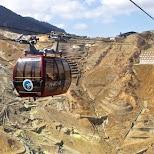Owakudani volcano valley of active gasses with the Hakone ropeway car in Hakone, Kanagawa, Japan