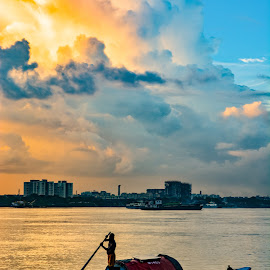 An evening in Kolkata by Arindam Patra - Landscapes Sunsets & Sunrises ( sky, sunset, clouds, river, boat )