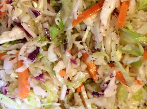 Pour the hot liquid over the coleslaw mix.