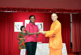 Photo: Parvathy Aarthy Annamalai, who has done well in A level, receiving the Award from Swamiji