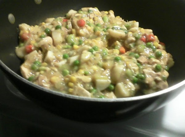 Add veggies and chicken to sauteed onion mixture and bring everything to a nice...