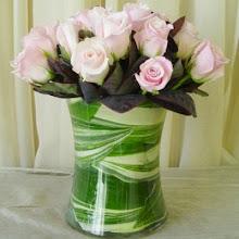 Photo: One Dozen Pink Roses $55.00 each.