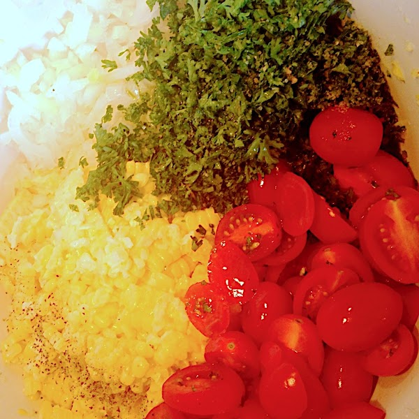Finely dice onion, mince parsley, and chop tomatoes - add everything to the bowl...
