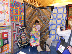 Photo: Visitors were attracted to the colorful booth.