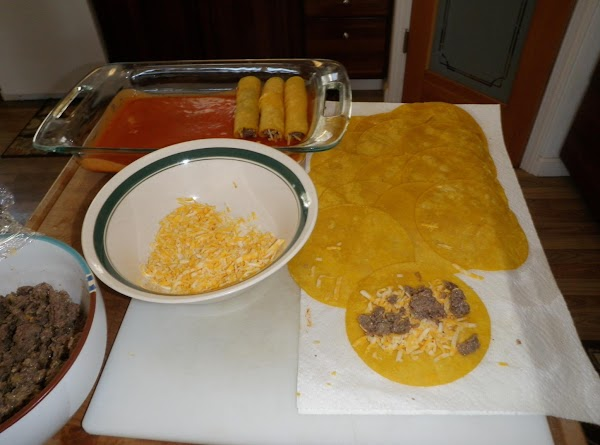 Place scant amount of cheese and caribou on softened tortillas and roll up.