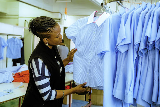 Seam dreams: Designer Pfadzani Exodus checks corporate wear designed by Exodus International. Picture: SUPPLIED