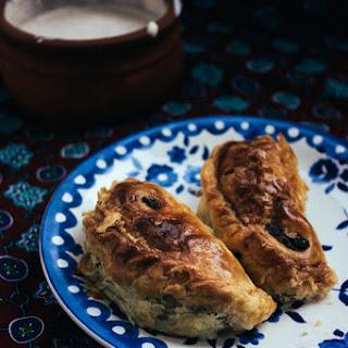 Roasted Eggplant + Black Bean Empanadas, Spicy Garlic Crema.