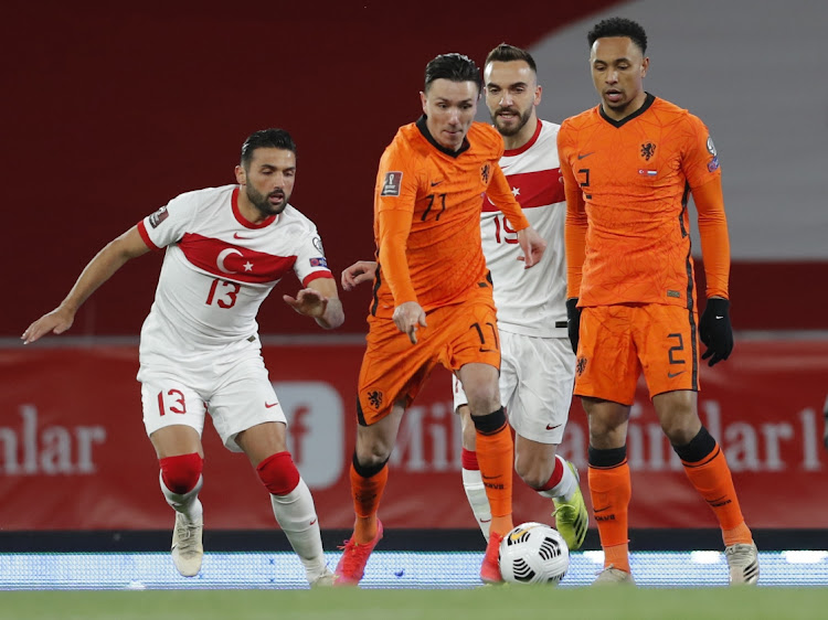 Netherlands' Steven Berghuis and Kenny Tete in their World Cup Qualifier against Turkey at Ataturk Olympic Stadium, Istanbul on March 24, 2021