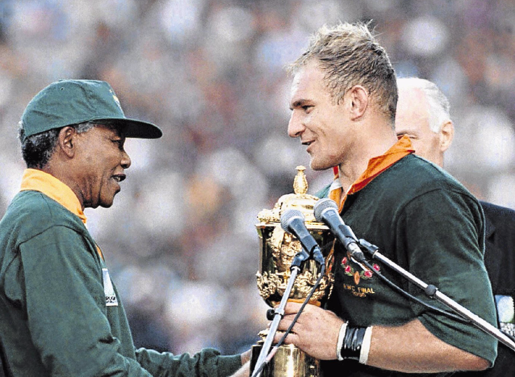 Nelson Mandela congratulates Springbok captain Francois Pienaar after the team beat the All Blacks to win the 1995 rugby World Cup. Among the themes at the conference is: 'Dressed for success: Historicising Nelson Mandela and the 1995 Rugby World Cup'.